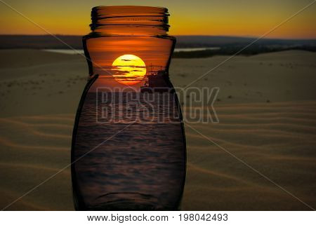 Sunset on the sea with colorful sky and fishing boat in the glass over the sand dunes with sunset abstract photo contrast concept
