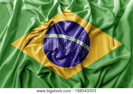 Ruffled waving Brasil flag national close up