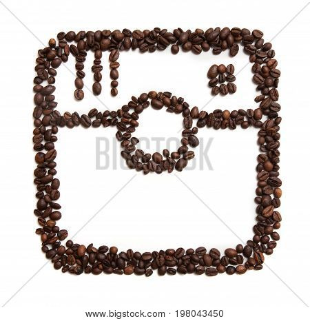 Kharkov, Ukraine - April 19, 2017: Icon of Instagram made of coffee beans on white background. Instagram is social network and simple way to capture and share the world's moments by photos