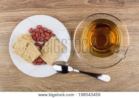 Peanuts And Peanut Halva In Plate, Tea And Teaspoon