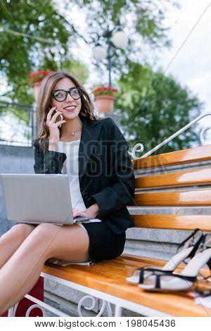 Modern technology. Telecommunication on street, woman workaholic at work