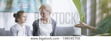 Woman And Girl Smiling During Psychotherapy