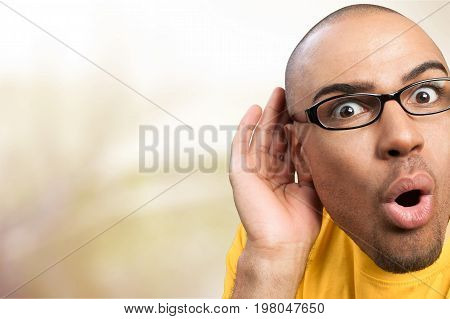 Man hand listening listen ear copy space man face
