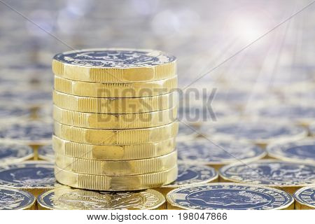 Stack Of Golden Coins With Bright Sunlight Light Effects.