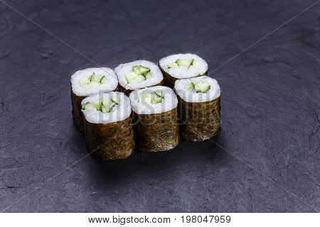 Sushi Rolls With Cucumber, Served On Black Stone Slate. Japanese