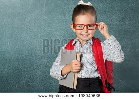 Beautiful holding girl book elementary age person human