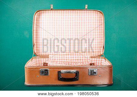 Empty vintage suit case suitcase white bag