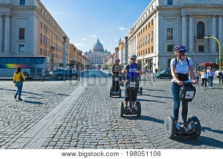 Rome Italy - September 29 2008: Tourists in Via della Conciliazione with the S.Pietro cathedral in the background