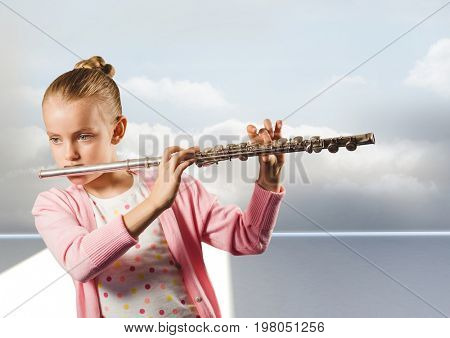 Digital composite of Girl playing the flute in front of clouds