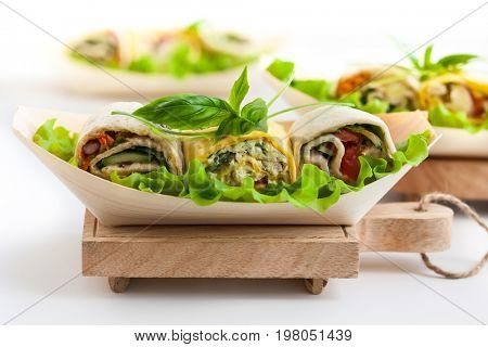 Assortment of fresh tortilla wraps with chicken, cheese and vegetables. Healthy fast food