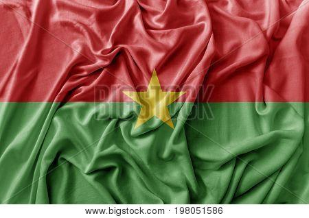 Ruffled waving Burkina Faso national flag close