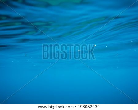 Wave underwater in sea. Blue ocean in underwater