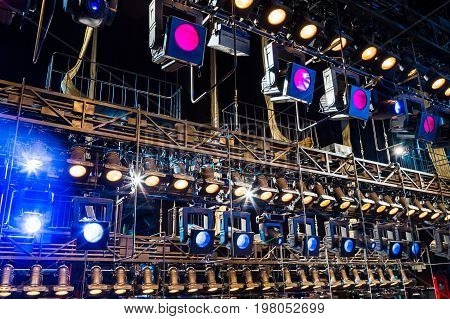 Lighting equipment on the stage. Multi-colored lights.