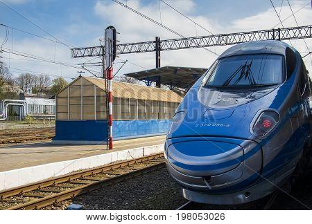 KOLOBRZEG, WEST POMERANIAN / POLAND: Express train waiting for passengers at the platform at the train station