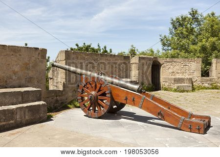 Ancient cannon at the La Mota Castle on top of Urgull mountain in the city of San Sebastian. Basque country Spain
