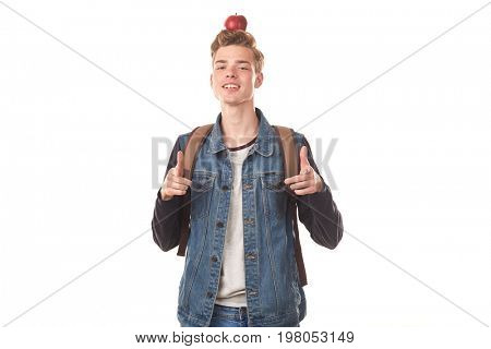 Portrait of teenage school boy posing with ripe red apple