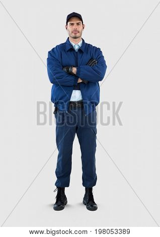 Digital composite of Full body portrait of security guard man standing with grey background