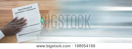 Digital composite of Person signing an insurance document