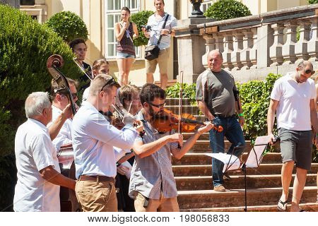 Buchlovice Czech Republic July 29 2017: Man playing the violin at folk festivals in the castle Buchlovice . Traditional farmers harvest celebrations of garlic.