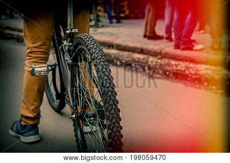 Tire bike wheel and bicyclist in the city