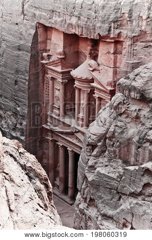 View of the red rose city of Petra from mountain Treasury facade.