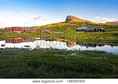 Norway country houses. Meadows and mountains. Blue cloudy sky. Nordic Scandinavia Europe travel