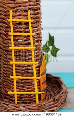 Yellow staircase handmade on a wicker tower