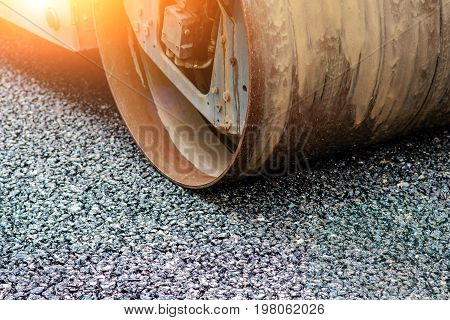 Background Of Asphalt Roller That Stack And Press Hot Asphalt. Road Repair Machine.
