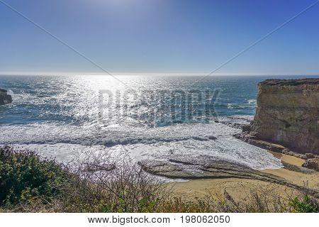 Waves crash ashore along the Pacific Coast Highway in California