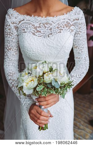 Beautiful Wedding Bouquet With White Roses And Peonies. In A Bride Hands In Narrow, Elegant White Dr