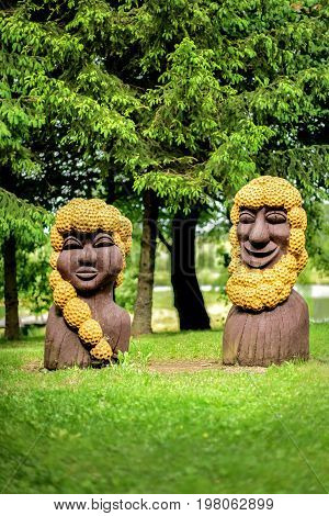 Lithuania, Vilnius - JUNE 20, 2017. National wooden statues in the garden on the lake shore