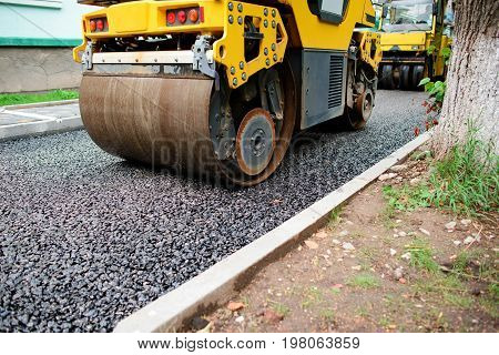 Background Of Asphalt Roller That Stack And Press Hot Asphalt. Road Repair Machine