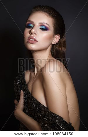 Beautiful sexy girl with professional colorful makeup, perfect skin, big lips, wet hair. Trendy colorful smoky eyes.