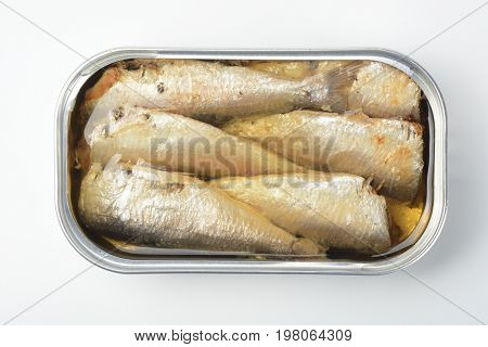 Canned sardines in vegetable oil on white background