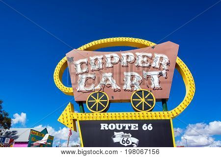 SELIGMAN AZ - SEPTEMBER 16: Old Copper Cart sign in Seligman AZ on September 16 2015