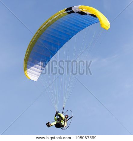 A parachutist in the sky . A photo