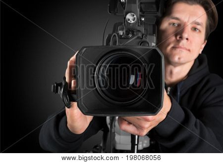 Holding man big camera video color view