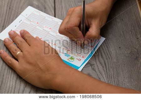August 2nd, 2017, Cork, Ireland - close up of someone filling out an Irish Daily Million ticket