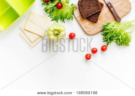 Preparing light vegetable lunch with cherry tomatoes, salad, bread, paprica