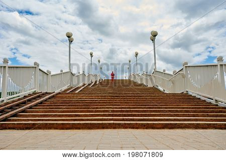 View of modern stone stairway on the background of blue cloudy sky
