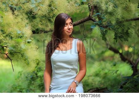 a young girl in a city Park with exotic tree