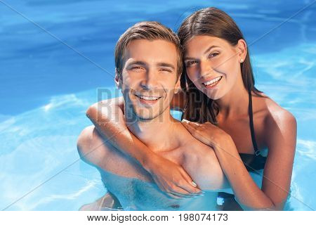 Blue water relax couple pool female young