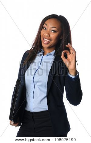 Beautiful African American businesswoman giving the OK sign isolated over white background