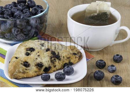 Fresh  with blueberries scone and a cup of tea