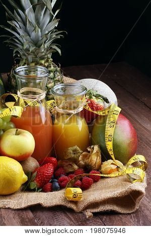 Healthy Lifestyle Concept. Measuring Tape Sport Fitness Equipment And Healthy Food And Juice (fruits