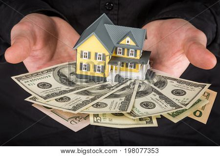 Money holding one model hands house man face
