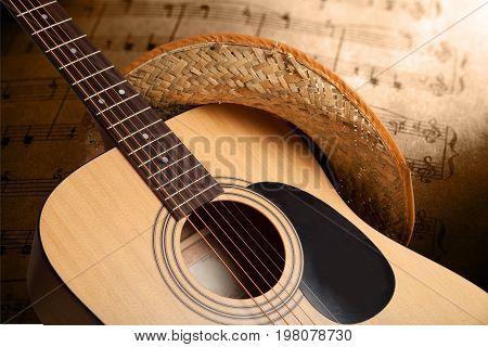 Hat guitar acoustic straw hat closeup art detail