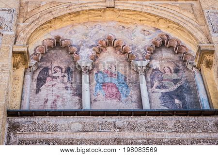 Cordoba, SPAIN - July 9, 2017: Exterior of the cathedral, detail of one of the 4 doors,