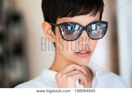 Portrait of eautiful young perfect model posing in fashion sunglasses