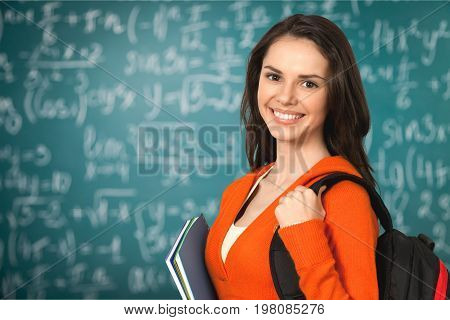 Young student teenage girl college student high school student isolated holding